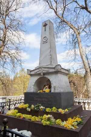 gory: PUSHKINSKIYE GORY, RUSSIA - MAY 02, 2010: Tomb of Russian poet AS Pushkin in the Holy Dormition Monastery