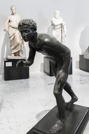 bce: NAPLES, ITALY - OCTOBER 03 2013: Bronze statue of athlete in Naples National Archaeological Museum. Copy or reworking of Greek original of the 4th century BCE by Lysipps school