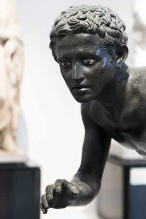bce: NAPLES, ITALY - OCTOBER 03, 2013: Head of bronze statue of athlete in Naples National Archaeological Museum. Copy or reworking of Greek original of the 4th century BCE by Lysipps school