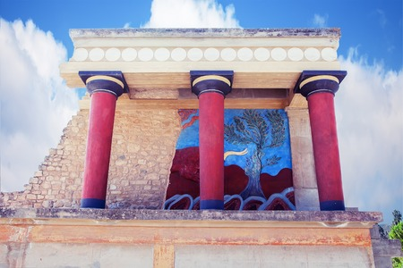 charging bull: CRETE, GREECE - JULY 26, 2015: Knossos Palace is the largest Bronze Age archaeological site on Crete. Restored North Entrance with charging bull fresco Editorial