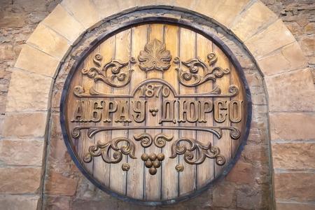producer: ABRAU-DURSO, RUSSIA - MAY 14, 2016: Sign Abrau-Durso winery. Abrau-Durso is Russias oldest sparkling wine producer
