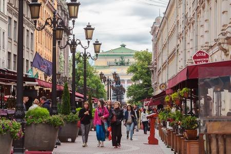 malaya: SAINT PETERSBURG, RUSSIA JULY 09, 2016: Tourists walk on pedestrian street in the center of St. Petersburg on Malaya Sadovaya, many street cafes