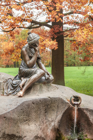 gir: PUSHKIN, ST. PETERSBURG, RUSSIA - OCTOBER 02, 2016: Sculpture girl with a jug in Catherine park in autumn. It is State Museum-Preserve in Tsarskoye Selo It is a former country residence of the royal family Editorial