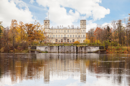 residences: GATCHINA, SAINT PETERSBURG, RUSSIA - OCTOBER 16, 2016: The Great Gatchina Palace and reflected in the Pond.  The Gatchina Palace was one of the favourite residences of the Imperial family.