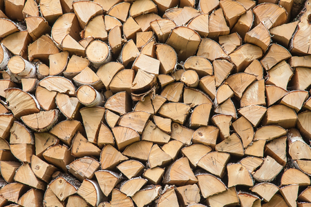 firewood background: Firewood background - chopped dry firewood Stock Photo