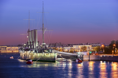 revolutionary: ST. PETERSBURG, RUSSIA � MAY 23, 2017: Russian cruiser Aurora - Russian protected cruiser at night, famous landmark, now it is museum ship Editorial