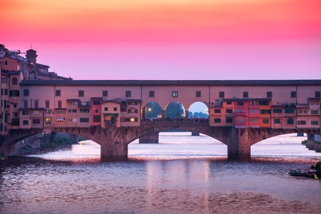 Bridge Ponte Vecchio in Florence at sunset, Italy