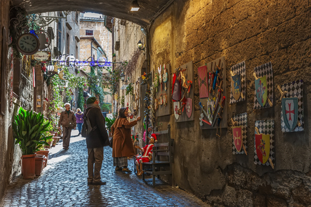 Orvieto, Italy – March 24, 2018:  Old street in the center of the city with ceramic souvenirs Editorial
