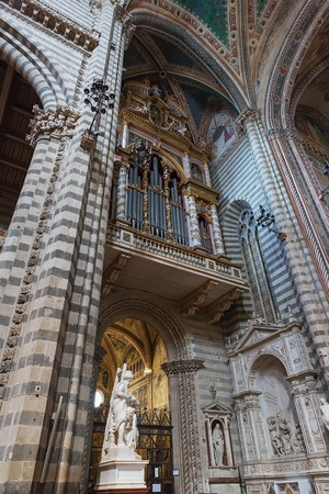 Orvieto, Italy – March 24, 2018:  Interior of Orvieto Cathedral, 14th-century Roman Catholic cathedral Stock Photo - 124584123