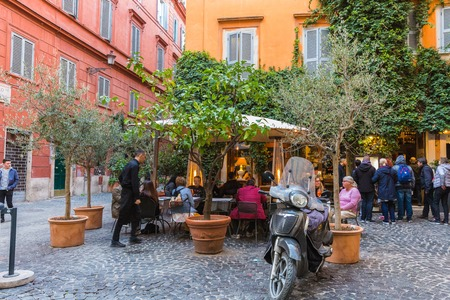 Rome, Italy – March 25, 2018: Outdoor cafe in the center of Rome, motorcycle