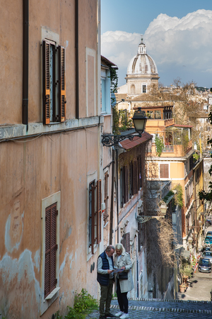 Rome, Italy – March 27, 2018:  Tourists on the street in the center of Rome