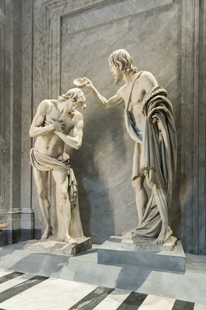 Rome, Italy – March 27, 2018:  Sculptural group The baptism of Christ inside Basilica San Giovanni dei Fiorentini