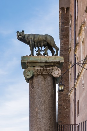 Column with ancient capitoline Wolf statue in Rome, Italy