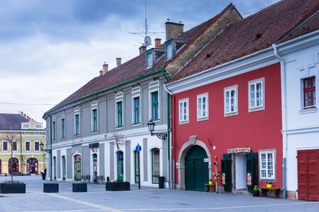 Eger, Hungary - March 07, 2019: Street with restaurants and shops in the center of Eger