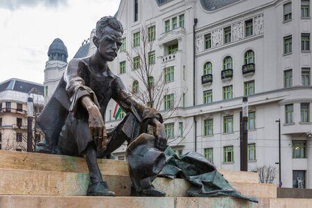 Budapest, Hungary - March 08, 2019:  Sitting Statue of poet Attila Jozsef