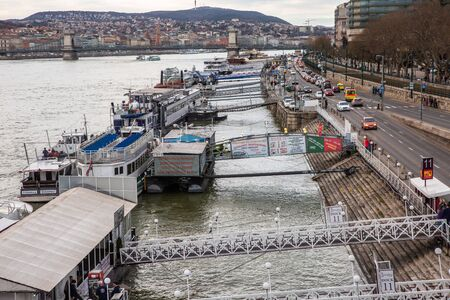 Budapest, Hungary - March 08, 2019: Tourist boats on the Danube River Standard-Bild - 137610293