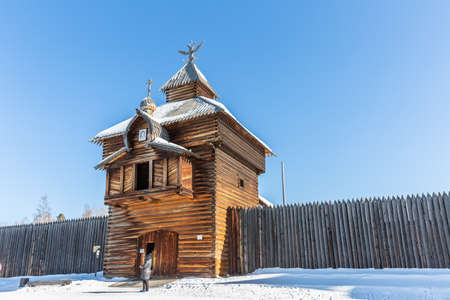 Russia, Irkutsk region - February 22, 2021: The Spasskaya (Savior tower) of Ilimsk Ostrog town (1667) in architectural and ethnographic Museum