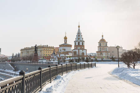 Russia, Irkutsk - February 21, 2021: View of the Cathedral of the Epiphany (1718 year of Foundation) and the monument to the founders of Irkutsk