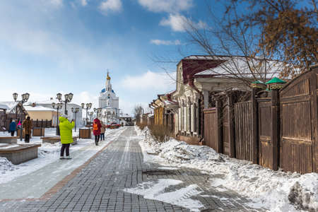 Russia, Ulan-Ude - February 27, 2021: Street in the center of Ulan-Ude with old carved wooden and stone houses Editorial