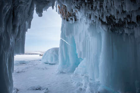Ice cave, Icicles in the rocky caves, Lake Baikal in winter, Siberia, Russia