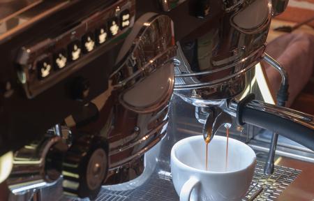espresso machine: Pulling espresso shot from espresso machine Stock Photo