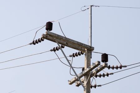 insulator: Porcelain insulator on electric pole Stock Photo