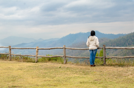 lonely woman at high mountain viewpoint