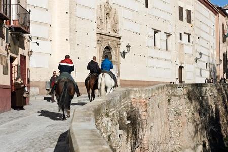 GRANADA, SPAIN - JANUARY 29: horsemen walk around Paseo