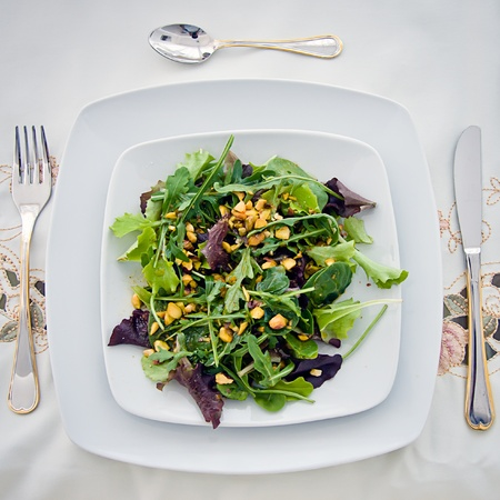 Delicious vegetable salad on a table photo