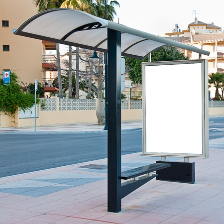 Empty white billboard at bus stop photo