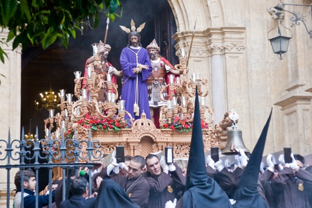 MALAGA, SPAIN - APRIL 01: traditional processions of Holy Week in the Cathedral on April 01, 2012 in Malaga, Spain. Procession of Dulce Nombre. Stock Photo - 13022680
