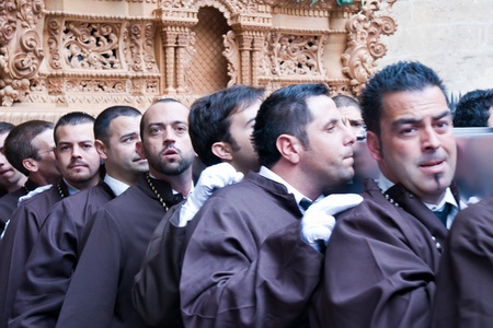 MALAGA, SPAIN - APRIL 01: traditional processions of Holy Week in the Cathedral on April 01, 2012 in Malaga, Spain. Porters of the images of Procession of Dulce Nombre.