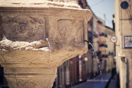 stone fountain in Xativa, Valencia, Spain photo