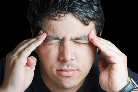 holding the head: young man holding head in pain Stock Photo