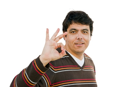 Portrait of a young man makes ok sign photo