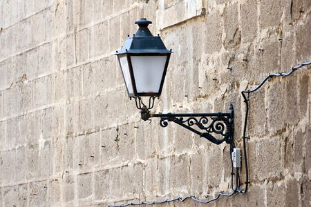 lamp in a stone wall photo