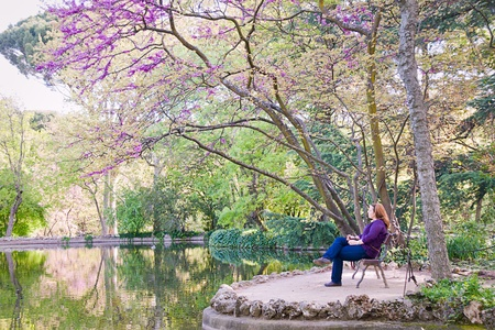 young woman in Capricho garden in Madrid, Spain Stock Photo