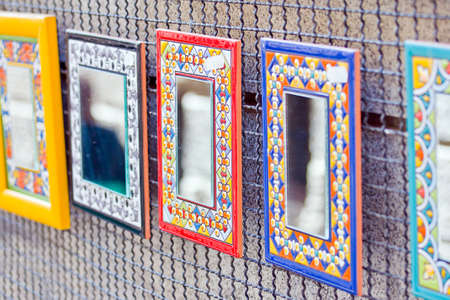 colorful decorative mirrors in a market photo