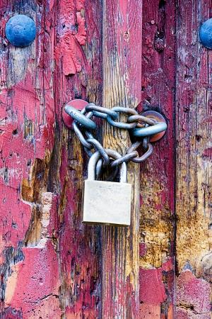 padlock in an old door