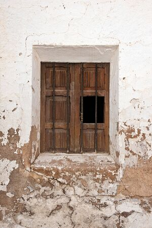 old  window in a stone wall Stock Photo - 16644476