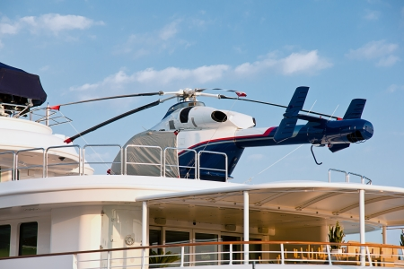 helicopter on the deck of the yacht photo