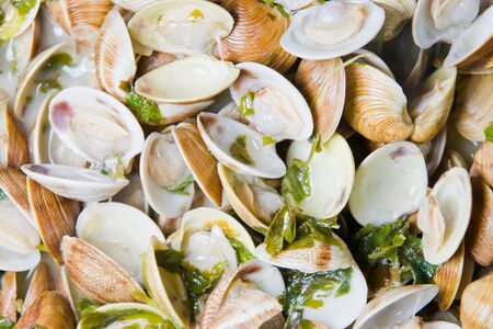 almejas: Spanish cuisine. Clams fishermans style. Almejas a la marinera.