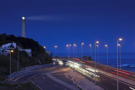 lighthouse and light trails in Mijas, Spain photo