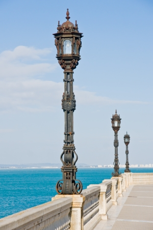 Lamps near the beach in Cadiz in Andalucia, Spain photo