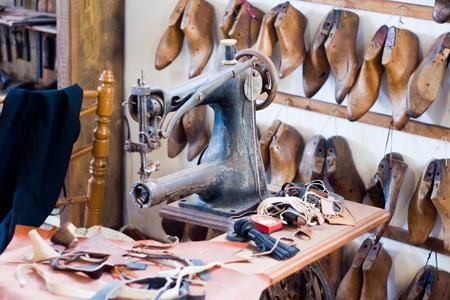 walking shoes: old shoe workshop Stock Photo