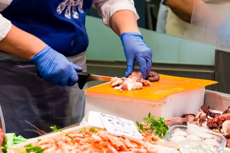 fishmonger: fishmonger in a market Stock Photo