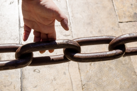 woman hand and  iron chain Stock Photo - 21537089