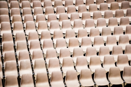 brown seats in a stadium photo