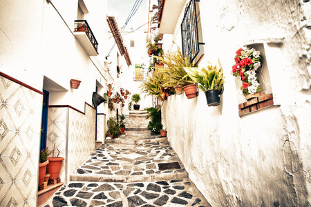 beaches of spain: street in Canillas de Albaida, Andalucia, Spain. Retro style. Stock Photo