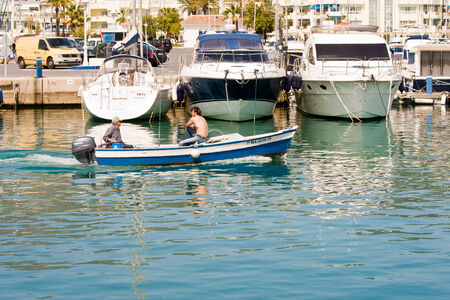 BENALMADENA, SPAIN - APRIL 09: A view of Puerto Marina on April 09, 2012 in Benalmadena, Malaga, Spain. This marina has berths for 1100 boats. It was opened on 1987.  Stock Photo - 22948285